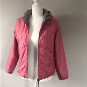 Girls Pink/grey North face reversible jacket.